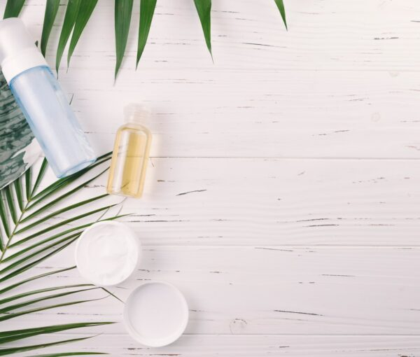 top-view-tropical-leaves-with-beauty-tools-cosmetics